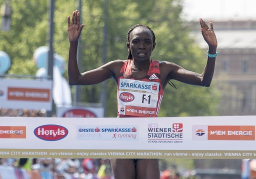 Nancy Kiprop of Kenya reacts as she crosses the finish line as the first the women during the Vienna City Marathon in Vienna, Austria, on April 22, 2018. More than 41000 athletes take part in the 35th Vienna City Marathon. PHOTO/AFP