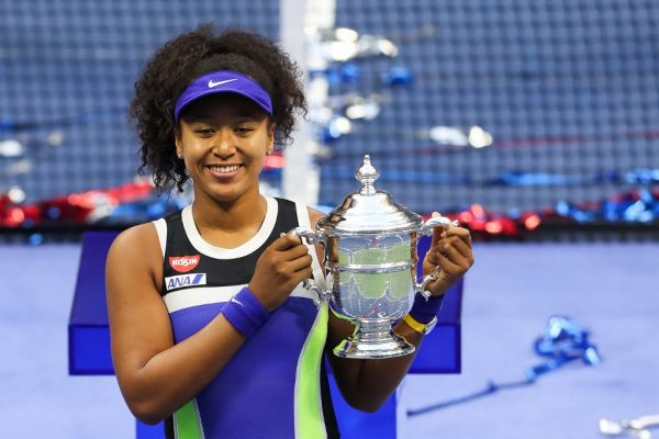 Naomi Osaka of Japan celebrates with the trophy after winning her Women's Singles final match against Victoria Azarenka of Belarus on Day Thirteen of the 2020 US Open at the USTA Billie Jean King National Tennis Center on September 12, 2020 in the Queens borough of New York City. PHOTO | AFP