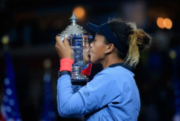 naomi_osaka_of_japan_kisses_the_championship_trophy_after_winning_the_women_s_singles_finals_match_against_serena_williams_of_the_united_states_on_day_thirteen_of_the_2018_us_open_at_the_usta_billie_jean_king