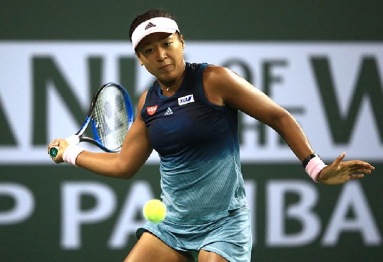 Naomi Osaka of Japan plays a forehand against Belinda Bencic of Switzerland during their women's singles fourth round match on day nine of the BNP Paribas Open at the Indian Wells Tennis Garden on March 12, 2019 in Indian Wells, California. PHOTO/GettyImages