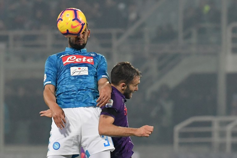 Napoli's Algerian defender Faouzi Ghoulam (L) and Fiorentina's Argentine defender German Pezzella go for a header during the Italian Serie A football match Fiorentina vs Napoli on February 9, 2019 at the Artemio-Franchi stadium in Florence. PHOTO/AFP