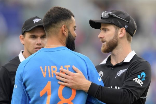 New Zealand's captain Kane Williamson (R) greets India's captain Virat Kohli at the end of play during the 2019 Cricket World Cup first semi-final between New Zealand and India at Old Trafford in Manchester, northwest England, on July 10, 2019. New Zealand beat India by 18 runs. PHOTO/AFP