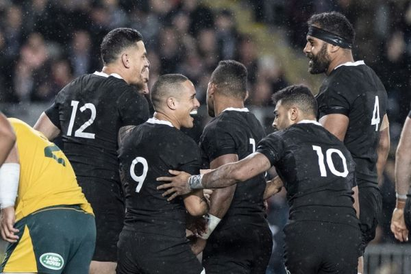 New Zealand's Sonny Bill Williams (L) celebrates a try with teammates during the Rugby Championship Bledisloe Cup Test match between the New Zealand All Blacks and Australia in Auckland on August 17, 2019. PHOTO   AFP