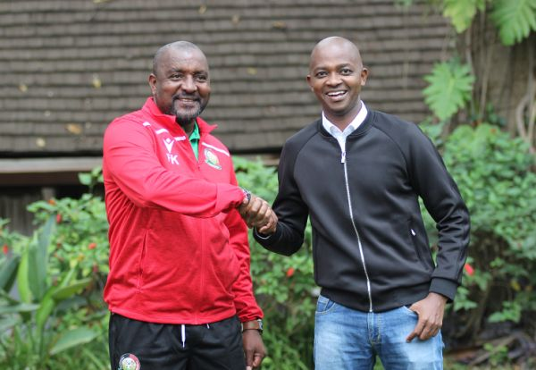 Newly appointed Harambee Stars head coach Francis Kimanzi (left) with Football Kenya Federation President Nick Mwendwa during his unveiling in Nairobi on August 20, 2019. PHOTO/ FKF