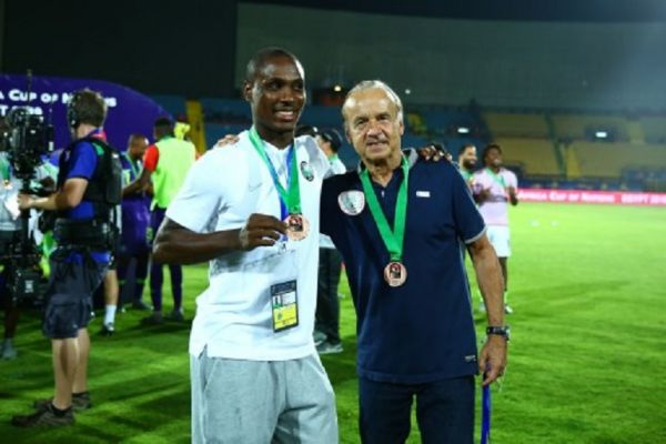 Nigeria's coach Gernot Rohr and Odion Ighalo celebrates after receiving a medal for winning the 2019 Africa Cup of Nations third place between Tunisia and Nigeria at the Al-Salam Stadium in Cairo, Egypt, on 17 July 2019. PHOTO/ AFP
