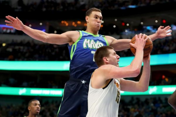 Nikola Jokic #15 of the Denver Nuggets drives to the basket against Dwight Powell #7 of the Dallas Mavericks in the second half at American Airlines Center on January 08, 2020 in Dallas, Texas. PHOTO | AFP