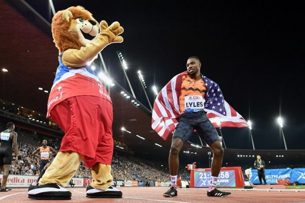 "Noah Lyles (R) of the US dances as he celebrates winning in the men's 200 metres race during the IAAF Diamond League ""Weltklasse"" athletics meeting at the Letzigrund stadium in Zurich on August 30, 2018. PHOTO 