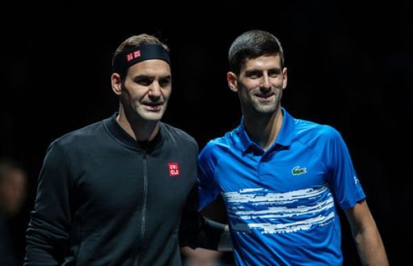 Novak Djokovic (R) of Serbia and Roger Federer of Switzerland pose for photos before their singles group match at the ATP World Tour Finals 2019 in London, Britain on Nov. 14, 2019. PHOTO | PA Images