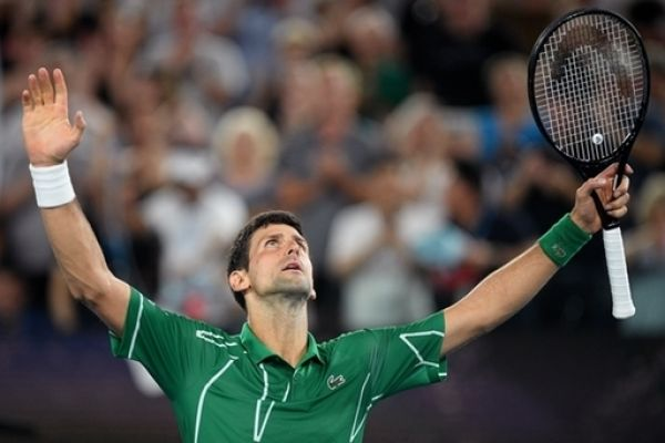Novak Djokovic of Serbia celebrates after winning the men's singles semi final against Roger Federer of Switzerland on day 11 of the Australian Open tennis tournament at Rod Laver Arena in Melbourne, Thursday, January 30, 2020. PHOTO | PA Images