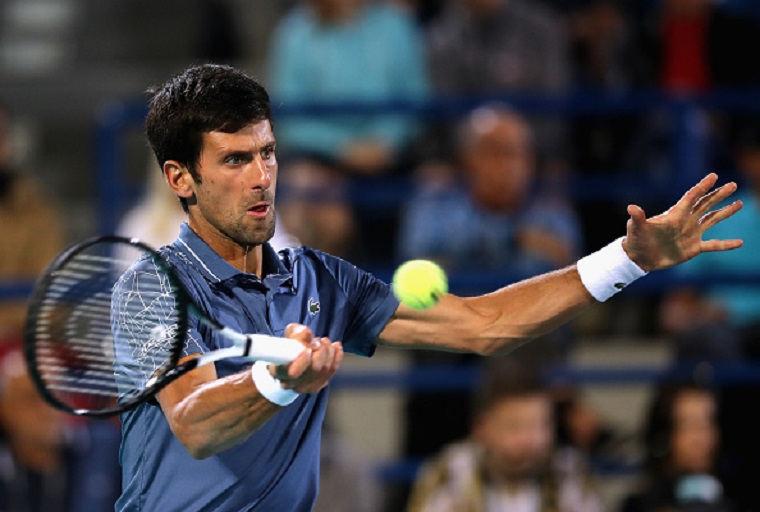 Novak Djokovic of Serbia hits a backhand against Federico Delbonis of Argentina in the third round of the men's singles in the Miami Open at the Hard Rock Stadium on March 24, 2019 in Miami Gardens, Florida. PHOTO/GettyImages