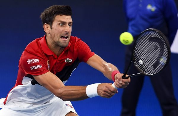 Novak Djokovic of Serbia hits a return in his men's singles match against Daniil Medvedev of Russia at the ATP Cup tennis tournament in Sydney on January 11, 2020. PHOTO | AFP