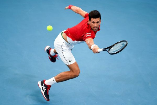 Novak Djokovic of Serbia hits a return in his men's singles match against Denis Shapovalov of Canada at the ATP Cup tennis tournament in Sydney on January 10, 2020. PHOTO   AFP
