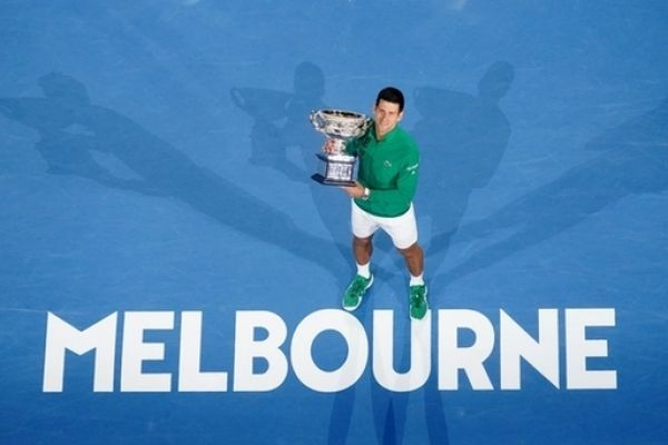 Novak Djokovic of Serbia poses for a photograph with the Norman Brookes Challenge Cup following the men's singles final on day 14 of the Australian Open tennis tournament at Rod Laver Arena in Melbourne, Sunday, February 2, 2020. PHOTO | PA Images