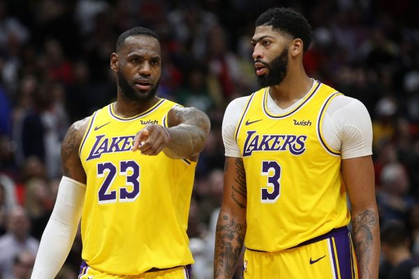 nthony Davis #3 of the Los Angeles Lakers and LeBron James #23 of the Los Angeles Lakers talk during the game against the New Orleans Pelicans at Smoothie King Center on November 27, 2019 in New Orleans, Louisiana. PHOTO | AFP