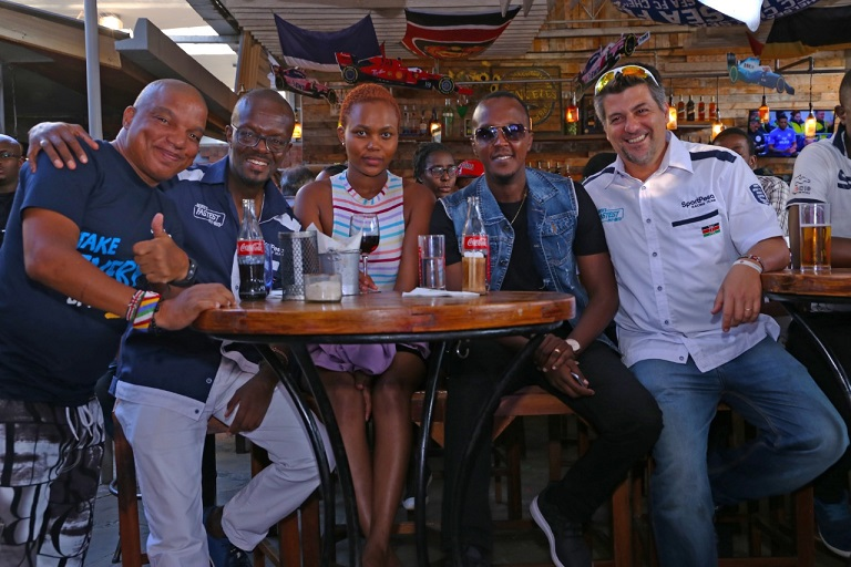 NTV sports anchor and reporter Sean Cardovillis (left), SportPesa Racing co-driver, Kigo Kareithi (2nd L), dance hall star, Kevin 'Love Child' Wyre (2nd R) and SportPesa Racing driver, Leo Varese (right) soak up Bahrain GP action on Sunday, March 31, 2019. PHOTO/Duncan Sirma/SPN