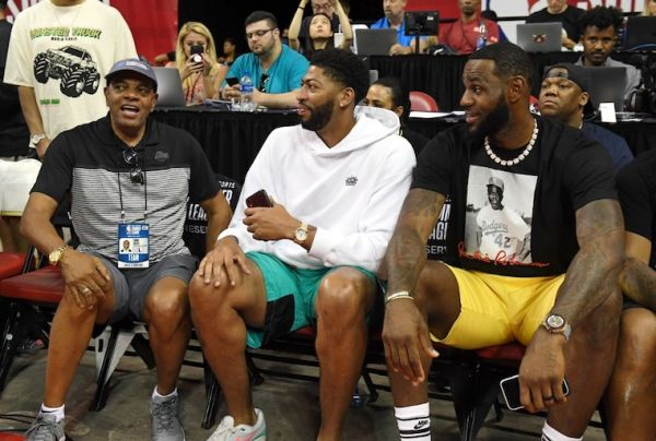 oach Lionel Hollins talks with Anthony Davis and LeBron James of the Los Angeles Lakers before a game between the Lakers and the LA Clippers during the 2019 NBA Summer League at the Thomas & Mack Center on July 6, 2019 in Las Vegas, Nevada. PHOTO/AFP