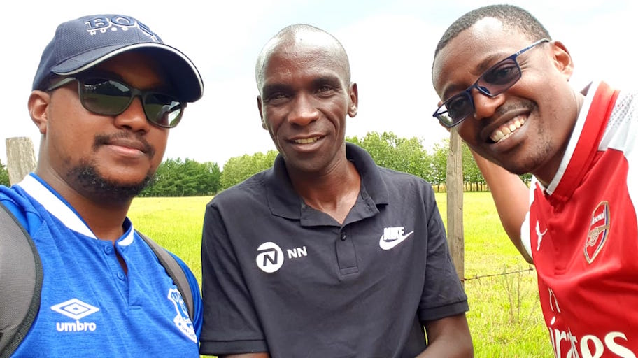 Olympic champion and world marathon record holder, Eliud Kipchoge (centre) flanked by SportPesa News Head of Digital, Farid Kipirash (left) and Senior Content Editor, Mutwiri Mutuota, during the visit of the pioneering A Day In Life feature segment at Eldoret on Tuesday, October 9, 2018. PHOTO/SPN