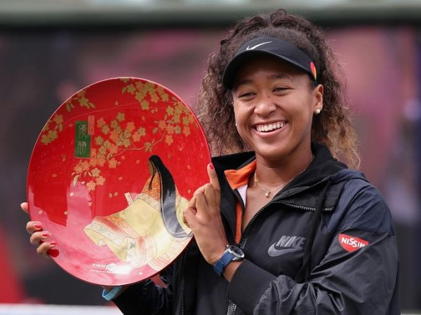 Pan Pacific Open women's singles winner Naomi Osaka holds a victory plate during the awarding ceremony in Osaka on September 22, 2019. PHOTO | AFP