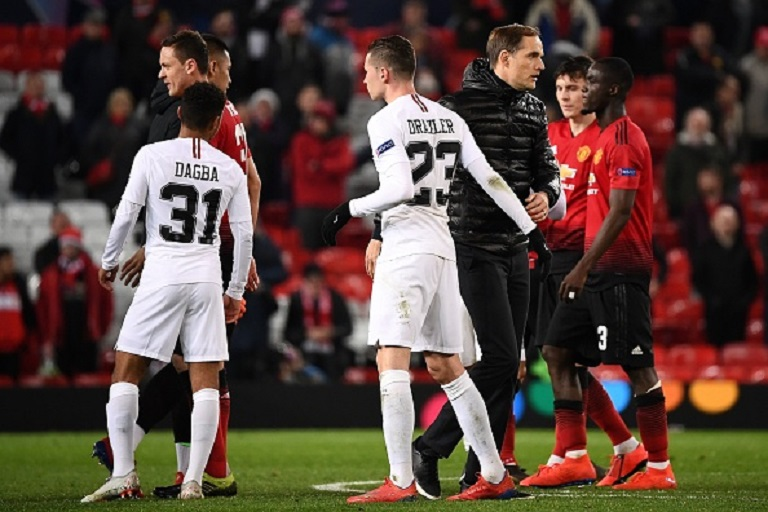 Paris Saint-Germain's German coach Thomas Tuchel (3R) congratulates his players follwoing the first leg of the UEFA Champions League round of 16 football match between Manchester United and Paris Saint-Germain (PSG) at Old Trafford in Manchester, north-west England on February 12, 2019. - PSG won the match 2-0. PHOTO/GettyImages