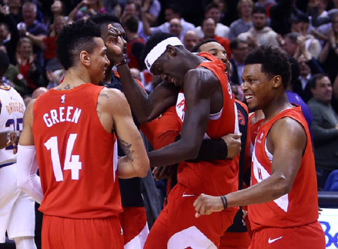 Pascal Siakam #43 of the Toronto Raptors celebrates with teammates after sinking the winning basket following the second half of an NBA game against the Phoenix Suns at Scotiabank Arena on January 17, 2019 in Toronto, Canada. PHOTO/GettyImages