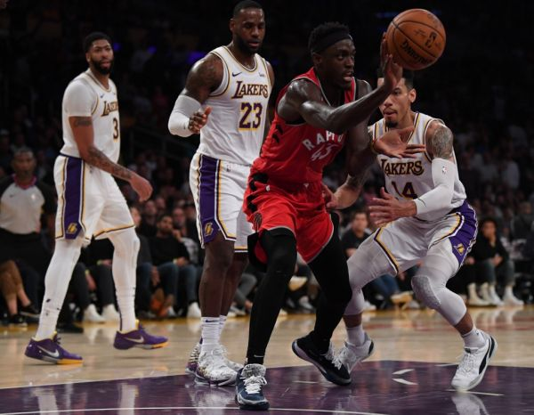 Pascal Siakam #43 of the Toronto Raptors passes in front of Danny Green #14, LeBron James #23 and Anthony Davis #3 of the Los Angeles Lakers during a 113-104 Raptors win at Staples Center on November 10, 2019 in Los Angeles, California. PHOTO | AFP