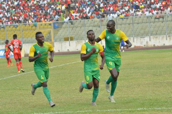Patillah Omotto (centre) celebrates scoring a goal for Kariobangi Sharks FC in their CAF Confederations Cup clash against Arta Solar 7. PHOTO/Courtesy/Kariobangi Sharks FC