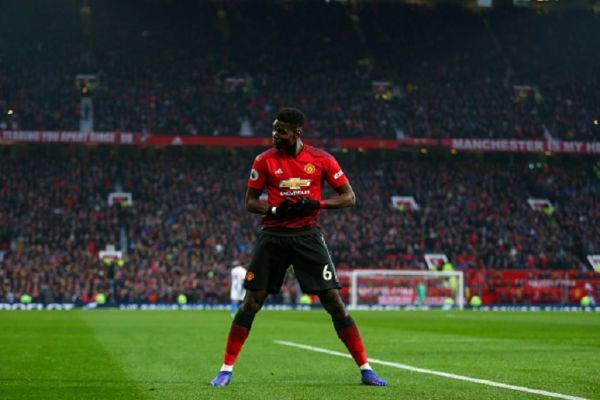 Paul Pogba of Manchester United celebrates after scoring a goal to make it 1-0 during the Premier League match between Manchester United and Brighton & Hove Albion at Old Trafford on January 19, 2019 in Manchester, United Kingdom.PHOTO/GETTY IMAGES