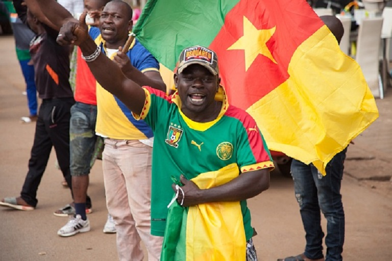 People greet as the Cameroon national team's convoy pass by during Cameroon national team's return to their home country in Yaounde, Cameroon on February 8, 2017. Cameroon celebrates it's 5th championship for the first time in last 15 years after winning the final match against Egypt, which was one of tournaments best teams, and receive the Africa Cup of Nations. Many citizens filled the streets of Yaounde to welcome the national team. PHOTO/GettyImages