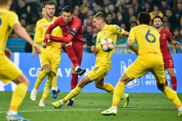 Portugal's forward Cristiano Ronaldo kicks the ball during the Euro 2020 football qualification match between Ukraine and Portugal at the NSK Olimpiyskyi stadium in Kiev on October 14, 2019. PHOTO | AFP