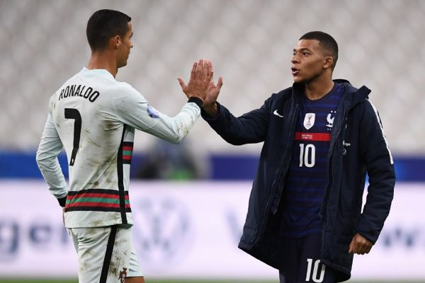 Portugal's forward Ronaldo (L) greets France's forward Kylian Mbappe at the end of the Nations League football match between France and Portugal, on October 11, 2020 at the Stade de France in Saint-Denis, outside Paris. PHOTO | AFP