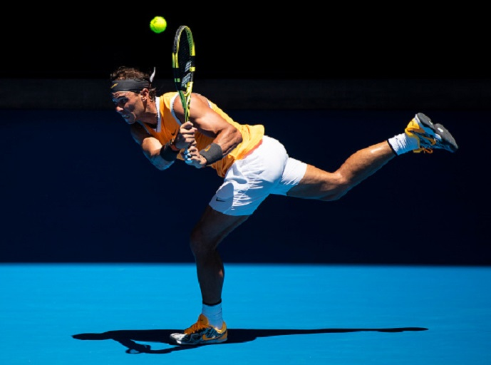 Rafael Nadal of Spain hits a backhand in his first round match against James Duckworth of Australia during day one of the 2019 Australian Open at Melbourne Park on January 14, 2019 in Melbourne, Australia. PHOTO/GettyImages