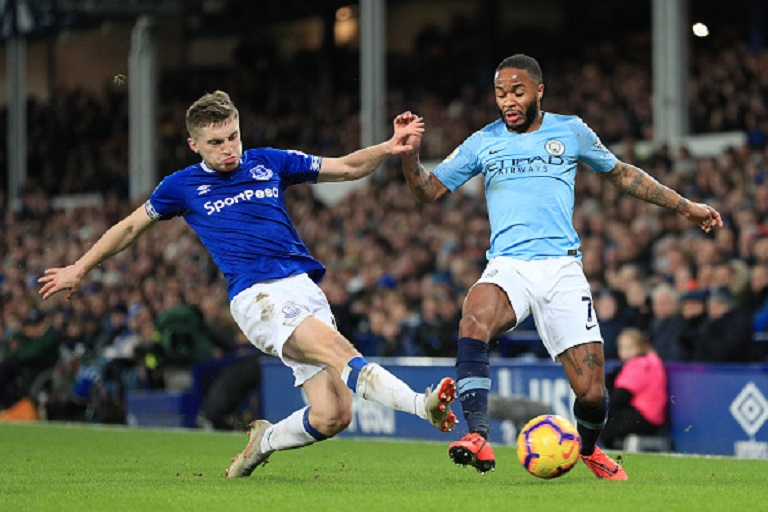 Raheem Sterling of Manchester City is tackled by Jonjoe Kenny of Everton during the Premier League match between Everton FC and Manchester City at Goodison Park on February 06, 2019 in Liverpool, United Kingdom. PHOTO/GettyImages