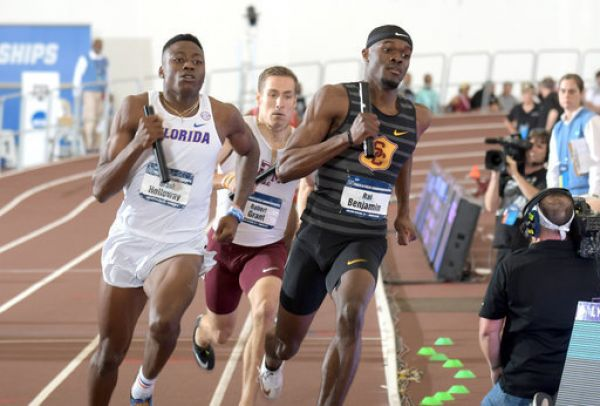 Rai Benjamin of Southern California and Grant Holloway of Florida run the second leg of the 4 x 400m relay during the NCAA Indoor Track and Field Championships at the McFerrin Athletic Center. USC won in a world record 3:00.77. PHOTO | AFP