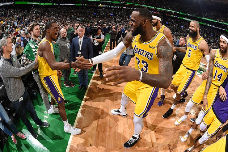 Rajon Rondo #9 and LeBron James #23 of the Los Angeles Lakers celebrate after the game against the Boston Celtics on February 7, 2019 at the TD Garden in Boston, Massachusetts. PHOTO/GettyImages