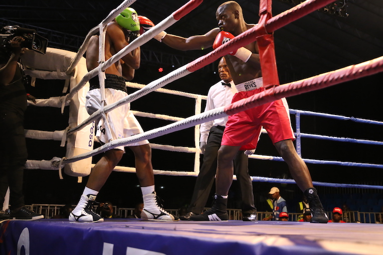 Rayton 'Boom Boom' Okwiri (right) overpowers his Tanzanian opponent, Pascal Bruno during their men Middleweight non-title fight during Nairobi Fight Night 2 on Saturday, March 23, 2019. PHOTO/Duncan Sirma/SPN