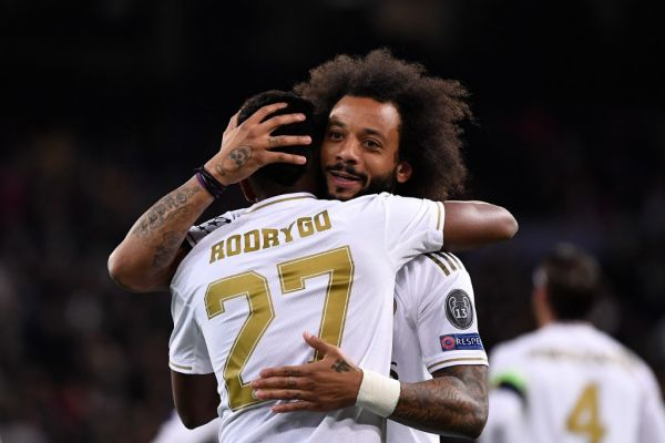 Real Madrid's Brazilian forward Rodrygo (L) celebrates with Real Madrid's Brazilian defender Marcelo after scoring during the UEFA Champions League Group A football match between Real Madrid and Galatasaray at the Santiago Bernabeu stadium in Madrid, on November 6, 2019. PHOTO | AFP