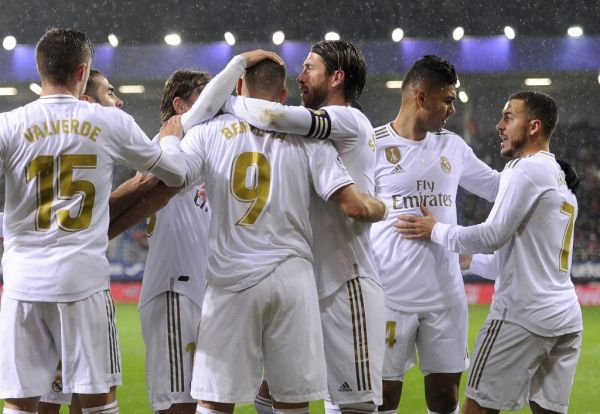Real Madrid's French forward Karim Benzema (C) celebrates with teammates after scoring a goal during the Spanish league football match between SD Eibar and Real Madrid CF at the Ipurua stadium in Eibar on November 9, 2019.  PHOTO | AFP