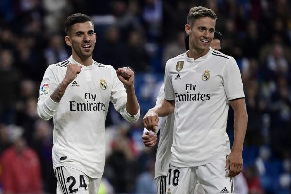 Real Madrid's Spanish midfielder Daniel Ceballos (L) celebrates with Real Madrid's Spanish miedfieder Marcos Llorente after scoring a goal during the Spanish League football match between Real Madrid CF and SD Huesca at the Santiago Bernabeu stadium in Madrid on March 31, 2019. PHOTO | AFP