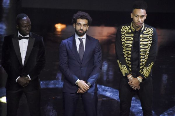 Recepient of the African Footballer of the Year Award Egypt and Liverpool striker Mohamed Salah (C) stands flanked by fellow nominees, Senegalese Sadio Mane (L) and Gabonese and Dortmund striker Pierre-Emerick Aubameyang (R) during The Confederation of African Football award ceremony at The International Conference Centre in Accra on January 4, 2018. PHOTO | AFP