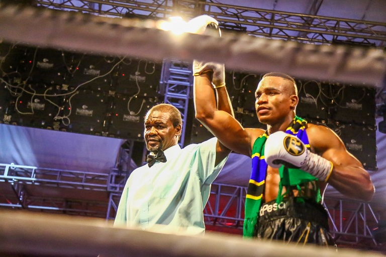 Referee Steve 'Vedo' Okumu holds the arm of Tanzania boxing sensation, Hassan 'Champez' Mwakinyo aloft after he won his men Super Welterweight fight against Sergio 'El Tigre' Gonzalez of Argentina on Saturday, March 23, 2019 during the main under card of Nairobi Fight Night 2. PHOTO/SPN