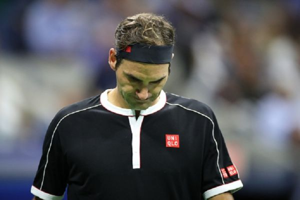 Roger Federer of Switzerland during his loss against Grigor Dimitrov of Bulgaria in the Men's Singles Quarter-Finals match on Arthur Ashe Stadium during the 2019 US Open Tennis Tournament at the USTA Billie Jean King National Tennis Center on September 3rd, 2019 in Flushing, Queens, New York City. PHOTO/GETTY IMAGES
