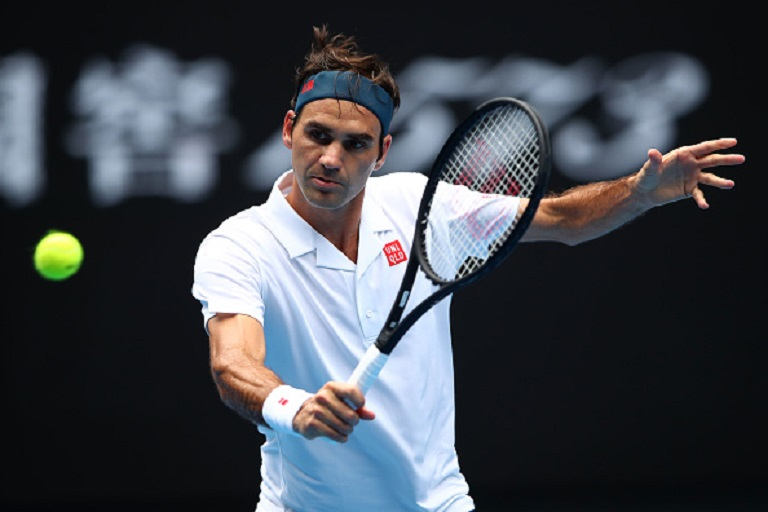 Roger Federer of Switzerland plays a backhand in his second round match against Daniel Evans of Great Britain during day three of the 2019 Australian Open at Melbourne Park on January 16, 2019 in Melbourne, Australia. PHOTO/GettyImages