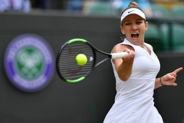Romania's Simona Halep returns against China's Shuai Zhang during their women's singles quarter-final match on day eight of the 2019 Wimbledon Championships at The All England Lawn Tennis Club in Wimbledon, southwest London, on July 9, 2019. PHOTO | AFP