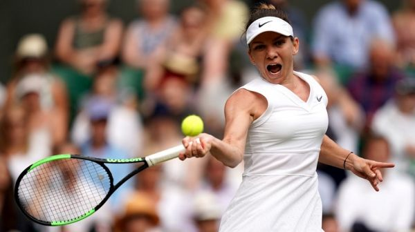 Romania's Simona Halep returns against Ukraine's Elina Svitolina during their women's singles semi-final match on day ten of the 2019 Wimbledon Championships at The All England Lawn Tennis Club in Wimbledon, southwest London, on July 11, 2019. PHOTO | AFP