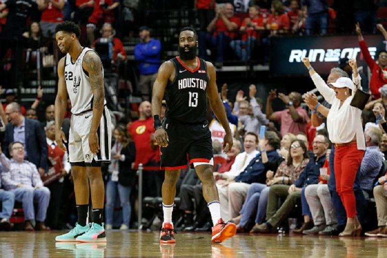 Rudy Gay #22 of the San Antonio Spurs reacts after a three point basket by James Harden #13 of the Houston Rockets in the fourth quarter at Toyota Center on March 22, 2019 in Houston, Texas. PHOTO/GettyImages