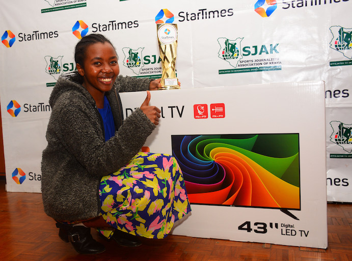 Sasha Mwongeli poses with her trophy and smart television following the presentation of the StarTimes/SJAK Sports Personality of the Month for October on Thursday, October 5, 2018. PHOTO/Courtesy