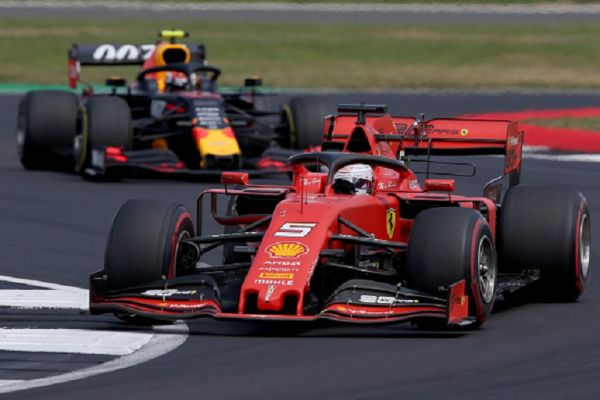 Sebastian Vettel of Germany driving the (5) Scuderia Ferrari SF90 leads Pierre Gasly of France driving the (10) Aston Martin Red Bull Racing RB15 on track during the F1 Grand Prix of Great Britain at Silverstone on July 14, 2019 in Northampton, England.PHOTO/ GETTY IMAGES
