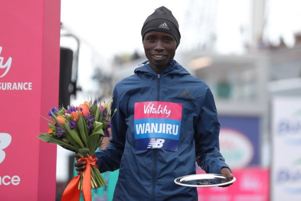 Second placed Kenya's Daniel Wanjiru poses with his trophy after the half marathon elite men's race during the inaugural The Big Half in London on March 4, 2018. PHOTO | AFP