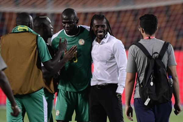 Senegal's coach Aliou Cisse (2nd-R) celebarates with his players after the 2019 Africa Cup of Nations (CAN) Round of 16 football match between Uganda and Senegal at the Cairo International Stadium in the Egyptian capital on July 5, 2019. PHOTO | AFP