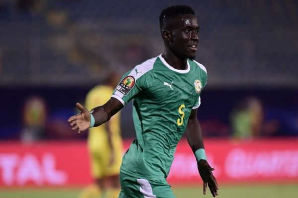 Senegal's midfielder Idrissa Gueye celebrates after scoring during the 2019 Africa Cup of Nations (CAN) quarter final football match between Senegal and Benin at the 30 June stadium in Cairo on July 9, 2019. PHOTO/AFP